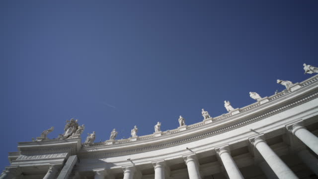 looking up at the blue winter sky above the vatican - vatikanstaat stock-videos und b-roll-filmmaterial