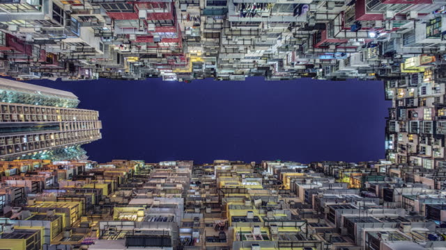 looking up between crowded hong kong apartments - directly below stock videos & royalty-free footage