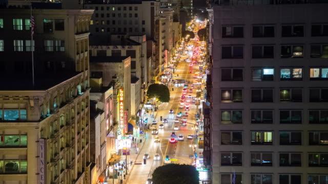 vídeos de stock, filmes e b-roll de looking up historic broadway in downtown la at night - câmara parada