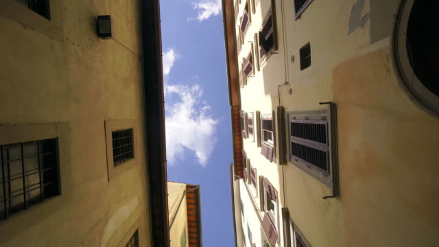 looking up in narrow street in florence, italy - florence stock videos and b-roll footage