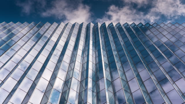 looking up on office building - glass material stock videos & royalty-free footage