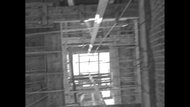 looking up side of building with taller one under construction behind it / various shots looks like camera aiming straight up on elevator as it... - bottle cap stock videos & royalty-free footage