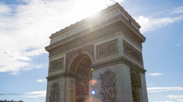 looking up the arc de triomphe in paris on a sunny day - french revolution stock videos & royalty-free footage