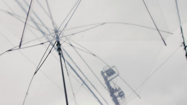 looking up through clear umbrella in rain in tokyo, japan. - grey colour stock videos & royalty-free footage