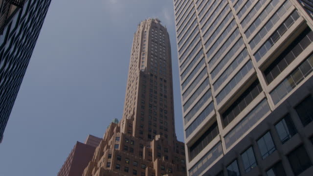 looking up to a skyscraper on 53rd and lexington ave.  pre war architecture. sotheby's art design museum. - sotheby's stock videos and b-roll footage