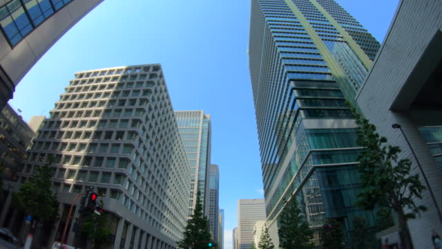 looking up view of skyscraper - marunouchi stock videos & royalty-free footage
