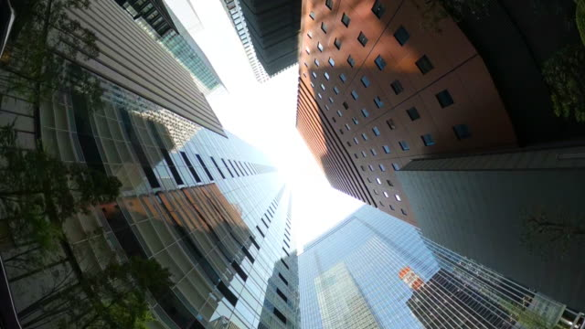 looking up view of skyscrapers. driving through skyscrapers in the city. - directly below stock videos & royalty-free footage
