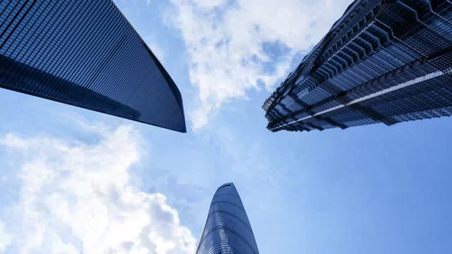 looking upwards in shanghai lujiazui with sun between skyscrapers - low angle view stock videos & royalty-free footage