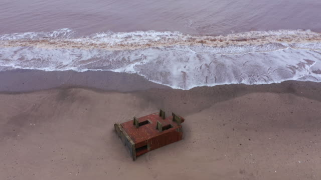 wwii lookout post which used to be situated on top of the cliffs observing the north sea now lays forlornly on the beach caused by coastal erosion of... - coastal feature stock videos & royalty-free footage