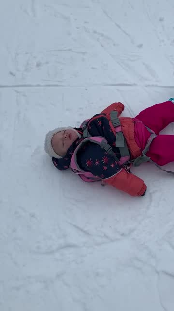 looks like 18-month-old baby nova would rather take a quick nap, rather than learn how to snowboard! that's too cute! - take that stock videos & royalty-free footage