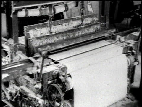 1921 montage loom refining asbestos and workers operating machines in large room / waukegan, illinois, united states - loom stock videos & royalty-free footage