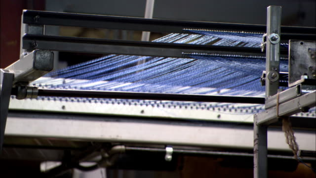 a loom weaves yarn in a factory. - loom stock videos & royalty-free footage