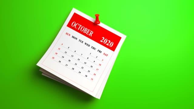 loop 3d october calendar 2020 year on green background - week stock videos & royalty-free footage