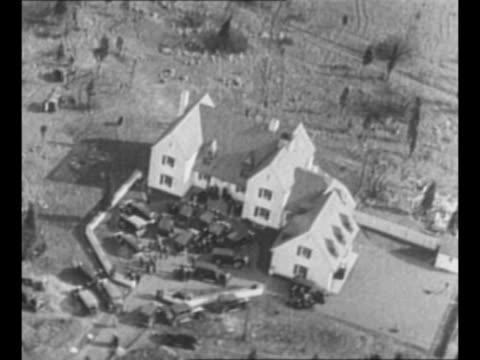 Loop Charles A Lindbergh Jr in crib / aerial Charles A Lindbergh's estate / montage investigators with ladder at side of Lindbergh home / car drives...