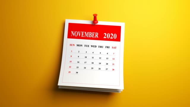 loop november month page of calendar 2020 year on yellow background - march month stock videos & royalty-free footage