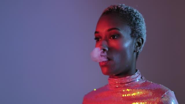 vidéos et rushes de loop of smoke in mouth of fashion model woman - cigarette