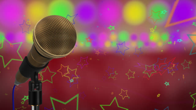 Loop ready close up of a gold coloured cardioid dynamic ball head microphone on a stand there are also rows of colours representing lights, haze and star particles all on a red background.