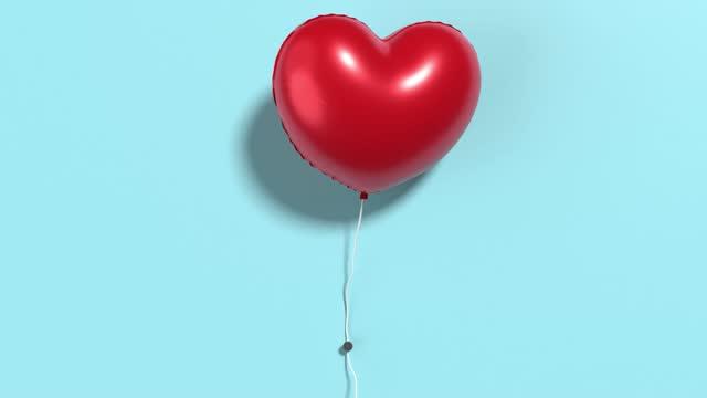 vídeos y material grabado en eventos de stock de globo de helio rojo listo para bucle en forma de corazón en pared pintada azul en resolución 4k - helio