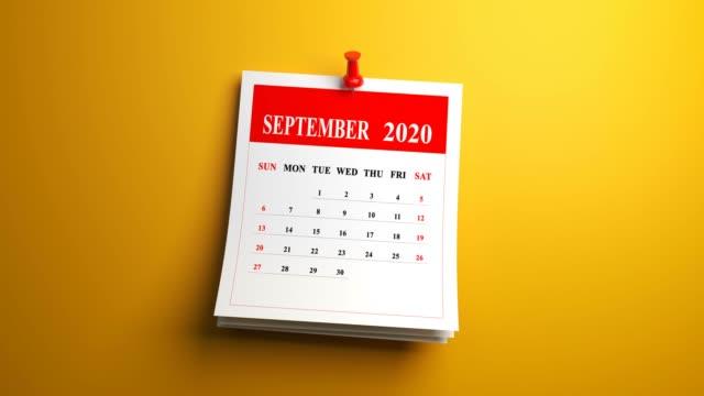 loop september page of calendar 2020 year on yellow background - week stock videos & royalty-free footage