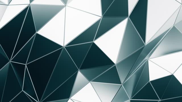 vídeos y material grabado en eventos de stock de fondo poligonal geométrico abstracto en bucle en metal cromado - geometría