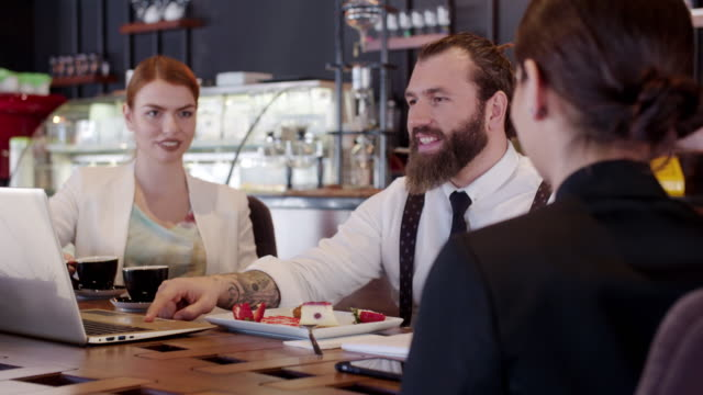 loopable cinemagraph: young business people at the restaurant - diner stock videos & royalty-free footage