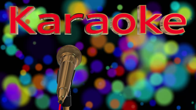 Loopable close up of a rotating gold coloured cardioid dynamic ball head microphone on a black background with glowing coloured particles, there is also the word karaoke in 3D gold letters with a red inlay