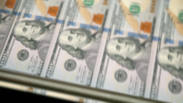 loopable close-up of printing $100 dollar bills, side view bureau of engraving and printing - american one hundred dollar bill stock videos & royalty-free footage