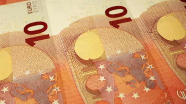 stockvideo's en b-roll-footage met loopable close-up toont afdrukken van €10 euro bankbiljet, europese centrale bank - tien euro