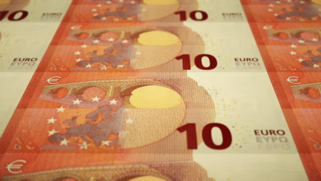 loopable close-up shows printing of €10 euro banknote, european central bank - printing press stock videos & royalty-free footage