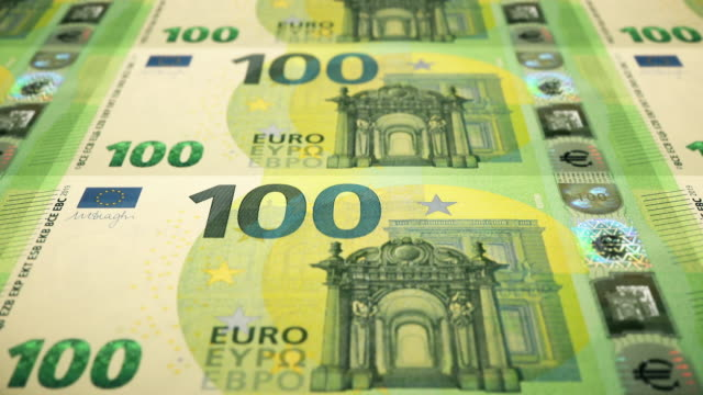 loopable close-up shows printing of €100 euro banknote, european central bank - euro symbol stock videos & royalty-free footage
