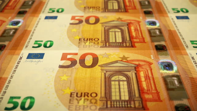 loopable close-up shows printing of €50 euro banknote, european central bank - printing press stock videos & royalty-free footage