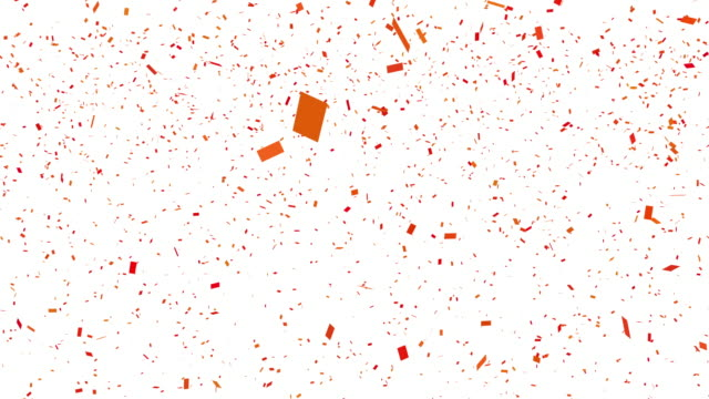 loopable falling orange and red confetti with alpha channel 4k - orange colour stock videos & royalty-free footage