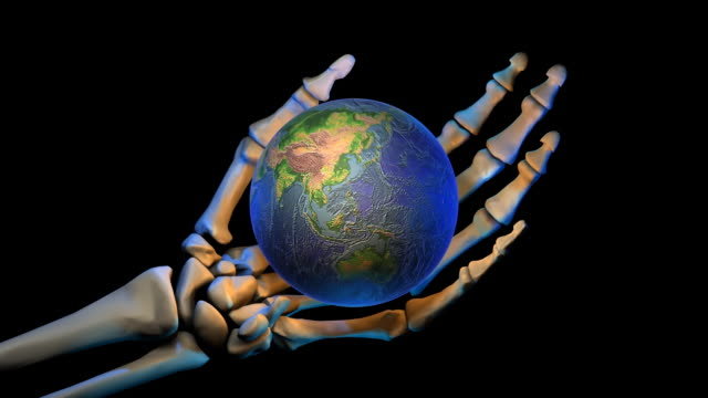 loopable, halloween, skeleton's hand with globe - genocide stock videos & royalty-free footage