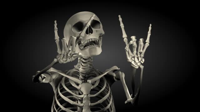 loopable, halloween spokesman skeleton - evil stock videos & royalty-free footage
