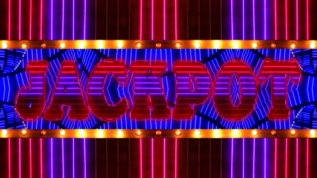loopable neon jackpot marquee - casinò video stock e b–roll