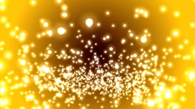 ゴールドのグラデーション背景 4 k 単発粒 - 球形点の映像素材/bロール