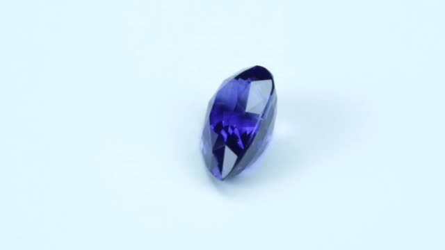 loopable, rotating blue sapphire - stone object stock videos & royalty-free footage