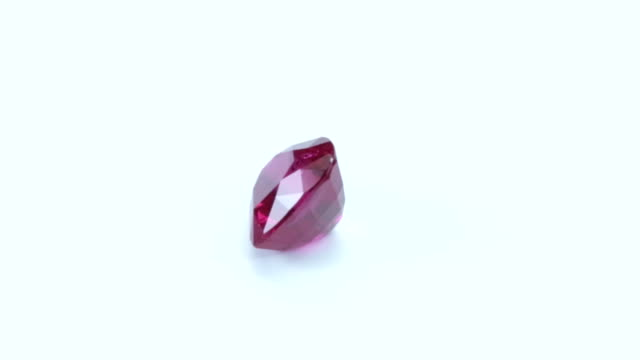 loopable, rotating pink sapphire - stone object stock videos & royalty-free footage