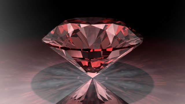 loopable, rotating red diamond - diamond gemstone stock videos and b-roll footage