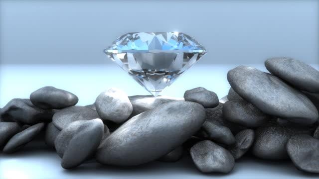 loopable, spinning diamond on rocks - diamond gemstone stock videos and b-roll footage