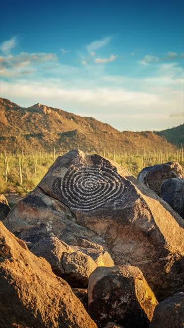 a loopable vertical cinemagraph of a native american indian spiral petroglyph at signal hill in saguaro national park, arizona - cactus drawing stock videos & royalty-free footage
