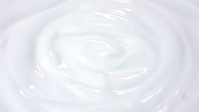 Loopable video of swirling yogurt in 4K