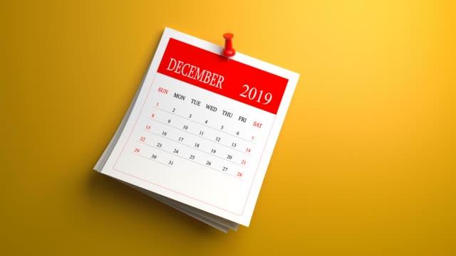 loopable waving december calendar 2019 on orange background - 2019 stock videos & royalty-free footage