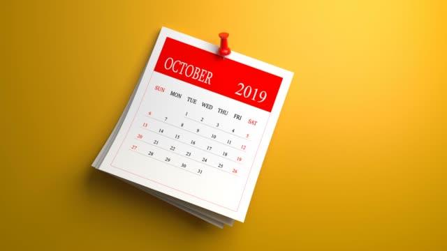 loopable waving october calendar 2019 on orange background - 2019 stock videos & royalty-free footage