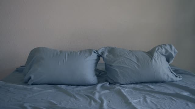 looped stop motion animation of dancing pillows - bed furniture stock videos & royalty-free footage