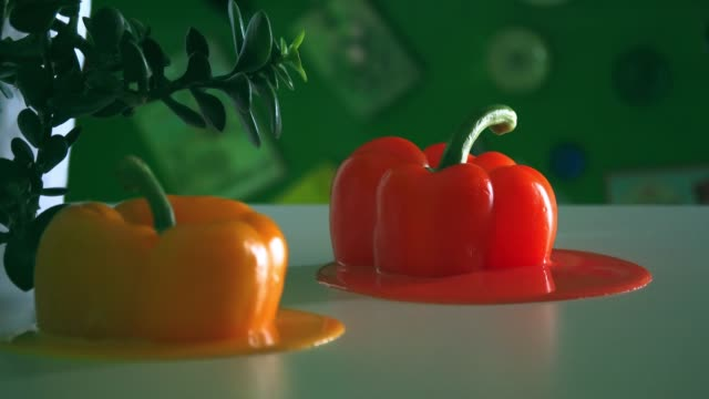 looped stop motion animation of melted sweet peppers - surrealism stock videos & royalty-free footage