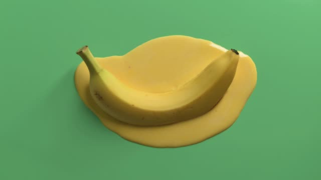looped stop motion animation of melting banana - surreal stock videos & royalty-free footage