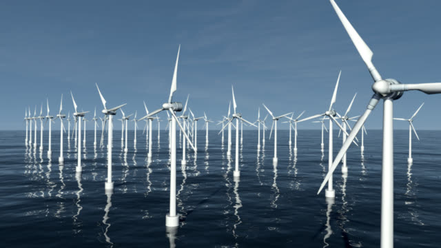 looping 4k wind turbines at sea - wind power stock videos and b-roll footage