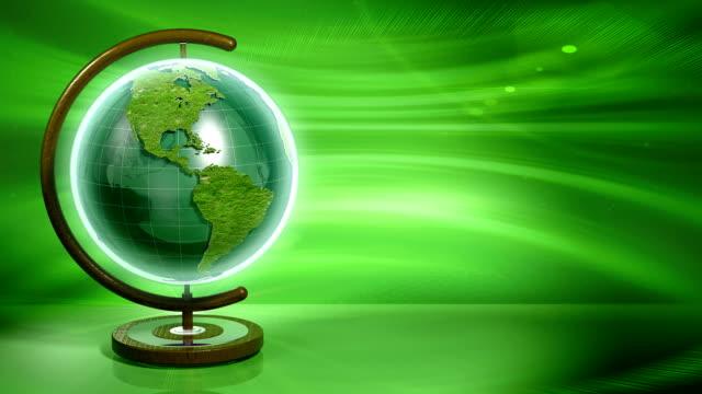 vídeos y material grabado en eventos de stock de fabricados de bucle tierra de la hierba verde - globo terráqueo para escritorio