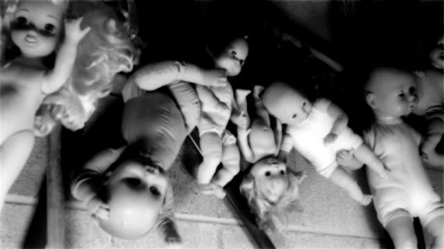 looping spooky dolls in a garage (multiple cuts possible) - doll stock videos and b-roll footage